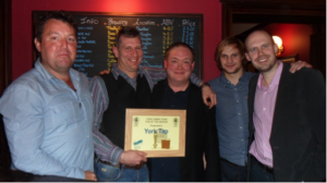 Nick (centre) presenting the award to Jon and the team
